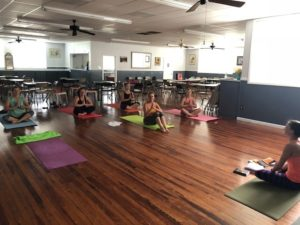 Photo of members doing Yoga at clubhouse
